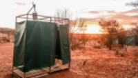 Enjoy a hot shower at our exclusive, semi-permanent eco-camps on the Larapinta Trail |  <i>#cathyfinchphotography</i>