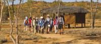 Trekkers embarking at the beginning of the Larapinta Trail, the old Telegraph Station | Peter Walton