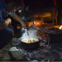 The Larapinta Guides still cook with traditional camp ovens over an open fire   Caroline Crick