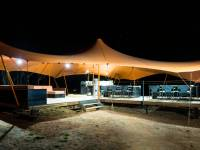 Solar powered LED lighting systems are just one of the sustainable technologies behind the Larapinta Camps  |  <i>Caroline Crick</i>