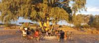 Trekkers enjoying a rest at campsite near Finke River | Linda Murden