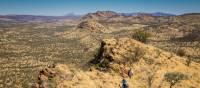 Trekkers making their way along the Larapinta Trail | Gavin Yeates